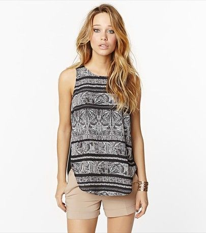 This dressy printed tank features a sexy cross over back!