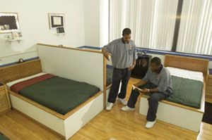 Two Job Corps students in their dorm room