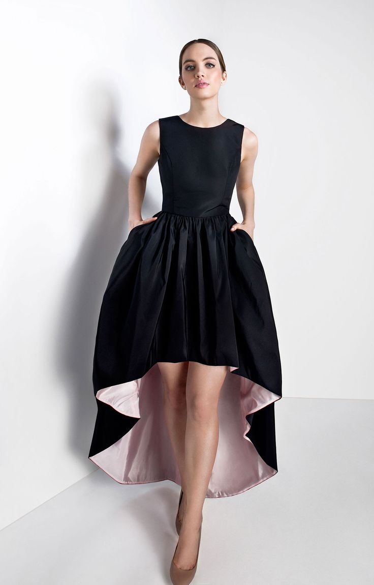 Jewel neckline; sleeveless  Open back, silk faille bodice with back bow details  Seam at natural waist  Gathered full high-low skirt  Side slit pockets  Concealed back zipper with hook an…