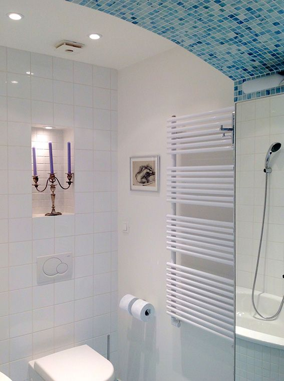 newly created space for bathroom with original arch - perfect place to use mosaic tiles to create spa like sanctury