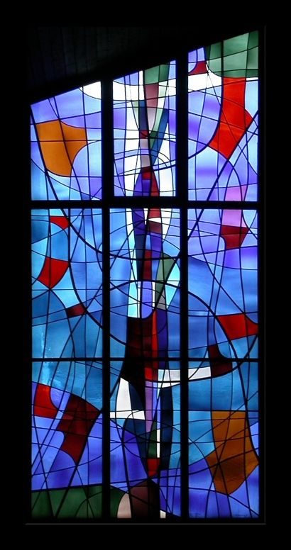 St-Geroge I - Malleray, Bern | Stained glass without title by Jean-François Comment, posed in 1982 in the St-Georges church. Jean-François Comment was born in Porrentry in 1919 and died in 2002. He created a lot of stained glasses in the canton Jura and elsewhere in Switzerland.