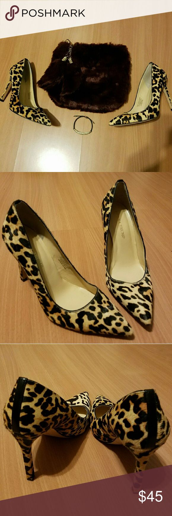 Calf Fur Long Hair Cheetah Print Pointed Toe Pumps Great Condition. Worn once to a wedding. Only worn on soles. Hair is not broken or bald. Pointed toes are not smashed.  Long Hair Cheetah Printed Pointed Toe Pumps.  Fur Info see Photo. Ivanka Trump Shoes Heels