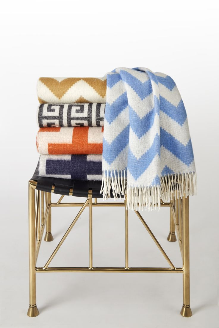 Add a dash of coziness and color to your living room with a super soft baby alpaca throw from Jonathan Adler