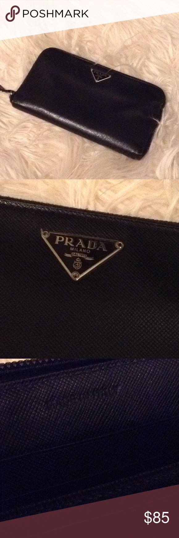 Prada wallet Authentic Prada wallet in fair condition, pull zipper disconnected. Prada Bags Wallets