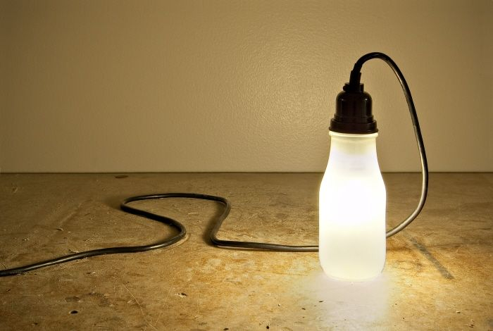 Lux - Ryan Mahan  lamp constructed by repurposing Starbucks Frappuccino bottle and old comuter power cords.... Love!!