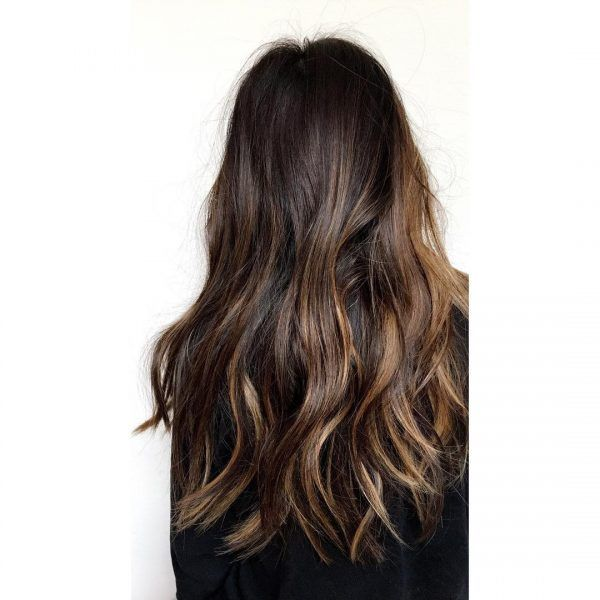 """For Multiple Tones - """"The tiger-eye or 'eclipting' color trend is big,"""" says Christine. """"Rich golden and chocolate tones are strategically placed [throughout the hair]. The inspiration is the name."""""""