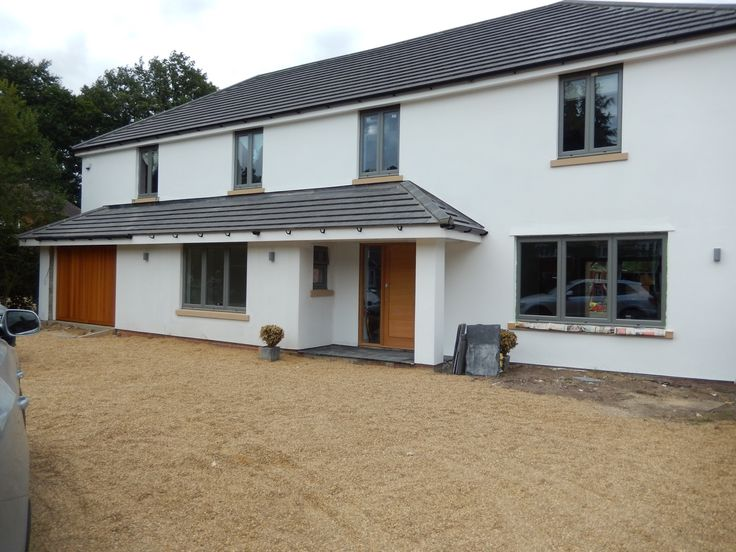 After picture   White rendered house with grey windows and grey roof                                                                                                                                                                                 More