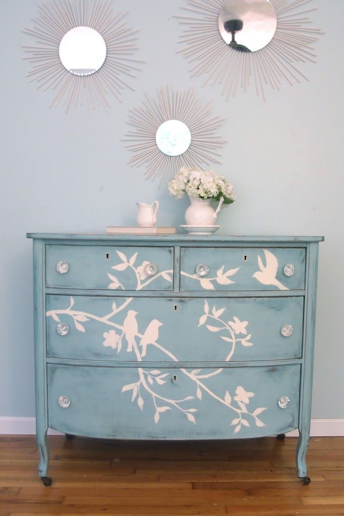Blue Bird Dresser transformation-  using chalk to draw design on drawer faces then paint over with chalk paint.