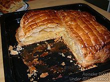 King cake (galette de rois) - traditional French Christmas dessert.The cake has a small trinket (often a small plastic baby, said to represent Baby Jesus) inside (or sometimes placed underneath), and the person who gets the piece of cake with the trinket has various privileges and obligations.