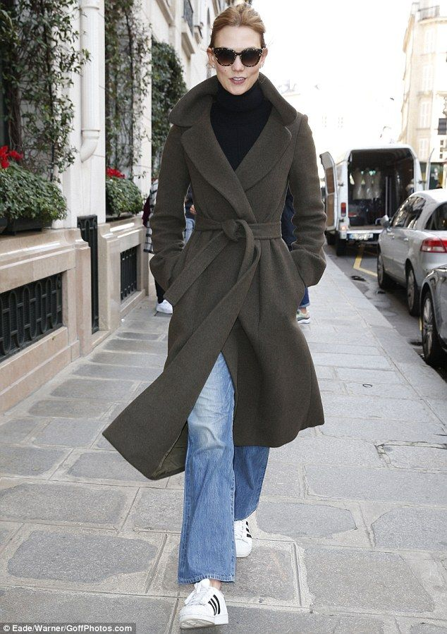 Flawless: The 23-year-old bundled up in an olive coat, a knitted turtleneck and jeans with her longtime beau, 30