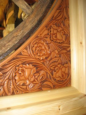 wagon wheel entry with carved leather panels in the corners-SR