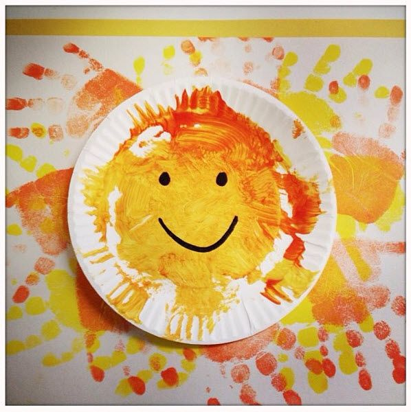 A handprint masterpiece from a toddler at KinderCare. #kindercare #toddler #preschool #craft #earlylearning #handprint #art #keepsake #parenting #painting #summer #sunshine #classroom #kids #children #sun #paperplate #recycle #diy
