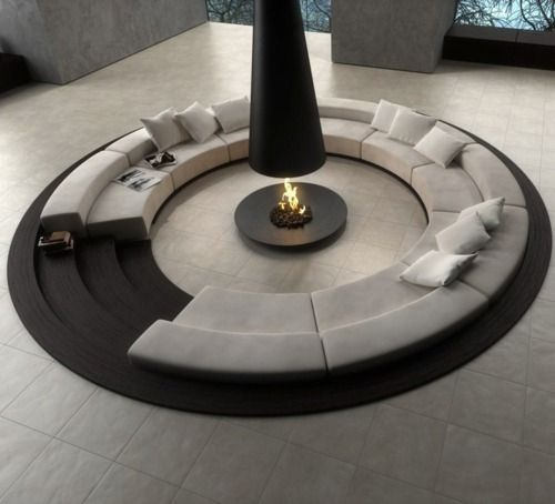 Round living room with fireplace in the centre