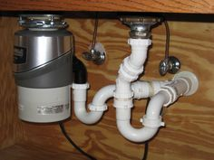 how to install a garbage disposal - double trap installation is ideal, but most times this is what the result looks like.