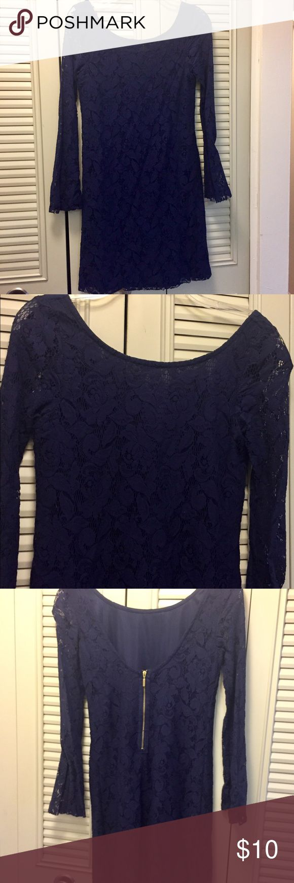 Zara lace dress This Zara dress is navy blue with lace. The sleeves are sheer lace but the bodice has a blue sheath underneath so it's not see through. It features a scoop necklace in the front, a slightly lower back and a gold zipper. Excellent condition. Perfect for spring weekends. Zara Dresses