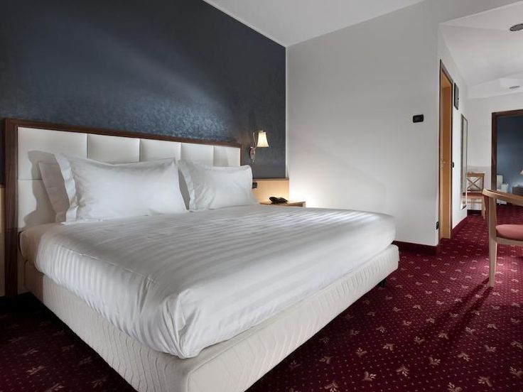 Milan Grand Hotel Milano Malpensa Italy, Europe Located in Malpensa Airport, Grand Hotel Milano Malpensa is a perfect starting point from which to explore Milan. Both business travelers and tourists can enjoy the hotel's facilities and services. Service-minded staff will welcome and guide you at the Grand Hotel Milano Malpensa. Designed for comfort, selected guestrooms offer television LCD/plasma screen, internet access – wireless, internet access – wireless (complimentary), n...