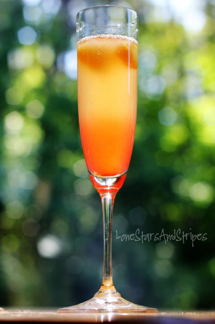 island mimosa 2 parts champagne or sparkling wine 1 part pineapple juice 1 part Malibu Coconut Rum dash of Grenadine frozen pineapple chunks, to garnish and keep drink chilled (optional)