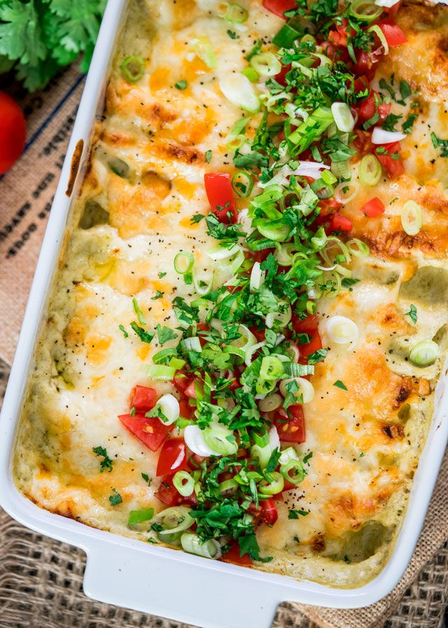 This Green Chile Chicken Enchilada Casserole can be on your dinner table in 30 minutes! It doesn't get any easier than these cheesy chicken enchiladas.