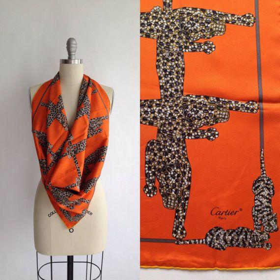 ERA: 1980s    LABEL: Cartier Paris    COLOR: Dark orange, black, charcoal gray, white    MATERIAL: Silk twill    CONDITION: Very Good