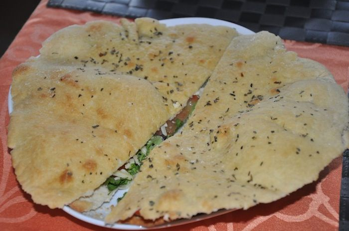 Pane Arabo is an Italian food recipe made with the same dough used to prepare pizza. Like in the image below is a sort of flat, unraised round focaccia bread which results for many people lighter than pizza or focaccia. Of course you need to be smart, to not over.