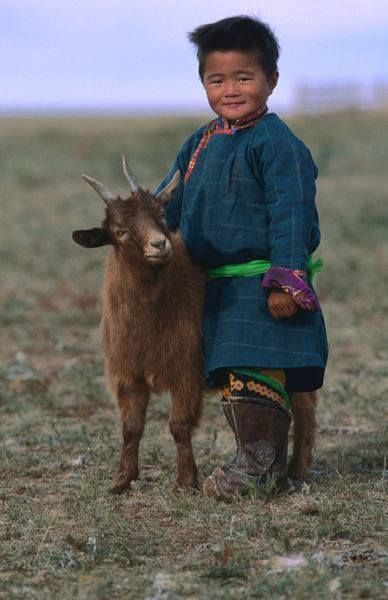 Little boy and goat. Photographer. location, date unknown. Something to check.