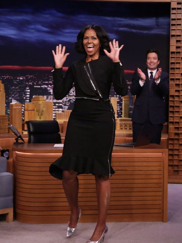 Michelle Obama's last appearance as First Lady on the Tonight Show with Jimmy Fallon Jan 11-17. Ms. Obama wore a Givenchy by Riccardo Tisci black crepe jersey jacket and skirt. The topper featured an asymmetrical hem and silver zippers along the front and arms. Her fluted hem skirt, paired with Jimmy Choo Romy 85 silver mirror-leather pointy-toe pumps, also had a similar zipper that traced the side.