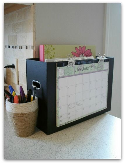 "How to get organized and design your home using Pinterest | The Butterfly Mom. Tackle the kitchen paperwork monster with this simple yet ultra effective ""command center"" via Lovely Crafty Home."