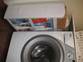 And we even got a rolling storage caddy from Target (for under twenty bucks) which fits perfectly beside our washer and dryer and holds all of our cleaning supplies: