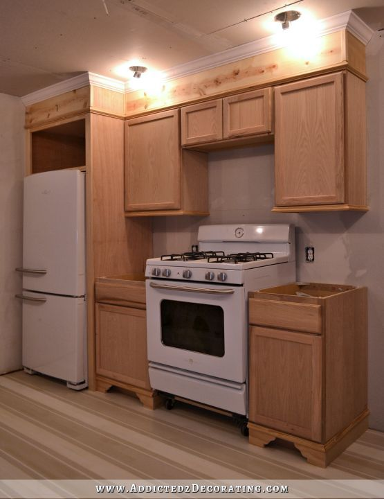 Post showing how to DIY framing in your fridge and walls above cabinets with trim