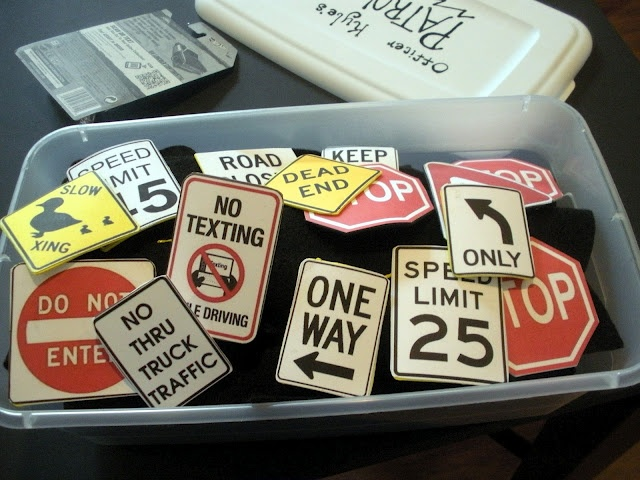 found images of road signs online. Printed them out and glued them on the back of craft foam to make them sturdy.