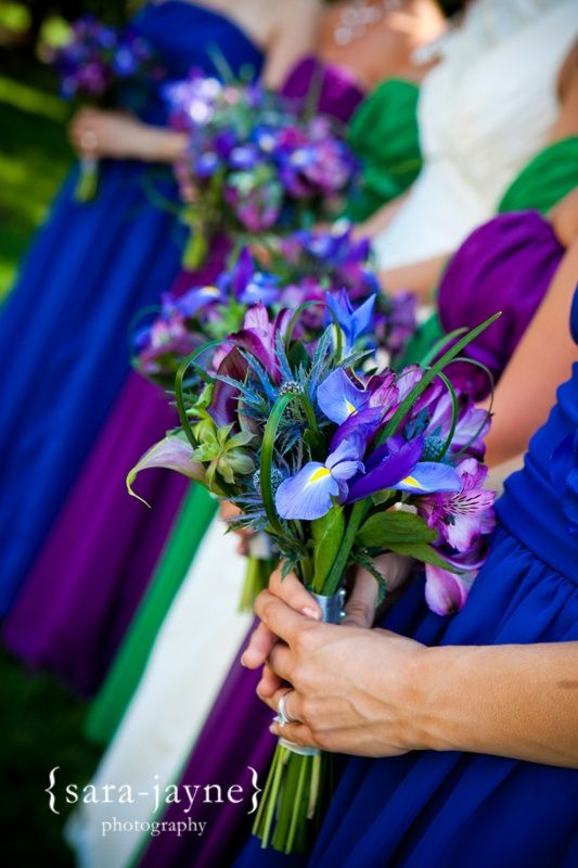 purple green blue wedding.  I dunno bout the three different colored dresses, but maybe.