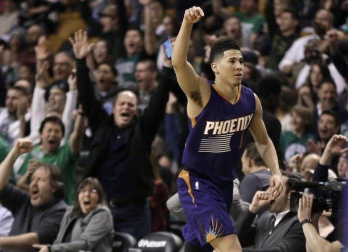 Booker scores 70 in Boston, but Celtics outlast Suns 130-120  By KYLE HIGHTOWER Today