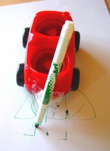 Car Drawing!  Take some of those small toy cars around the house and use them to draw! Tape a marker to the front or back and then let your little one push the car around on some paper to make a drawing.
