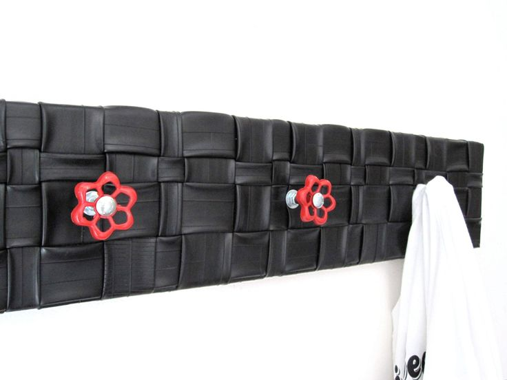 Upcycled decor / Eco Friendly Housewares / Bicycle  Inner Tube / Coat Rack / Garment Rack / Salvaged Faucets. $66.00, via Etsy.