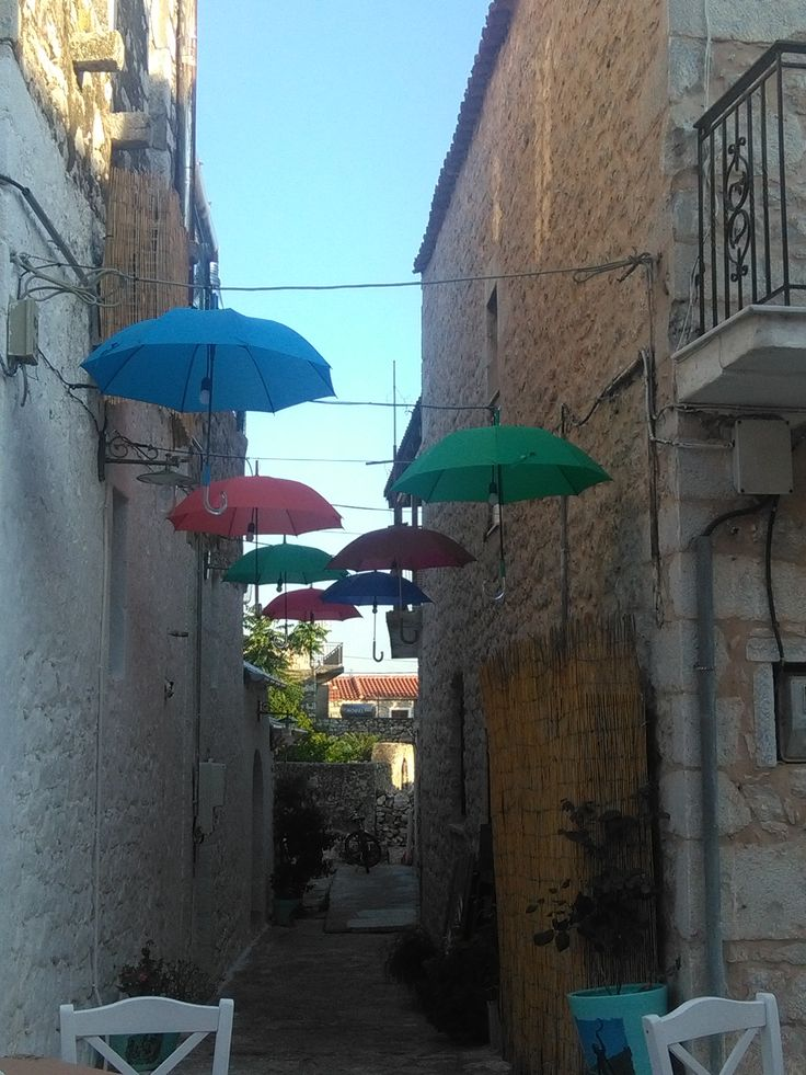 A beautiful alley with umbrellas in Areopoli
