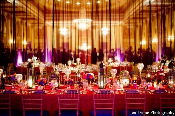 red, purple, gold,hot pink, black wedding reception lighting.
