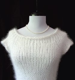 Easy knit sweater for a beginner  http://www.allfreeknitting.com/Knitted-Sweaters/airy-top-down-raglan-sweater/ml/1