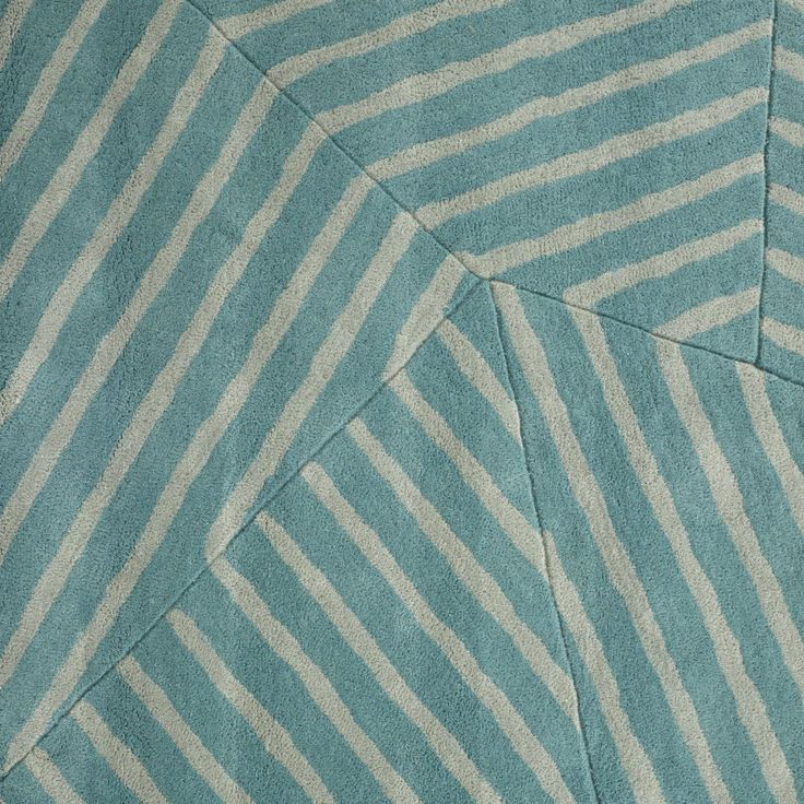 FEILDS rug. Ligne Roset City . Design based on 'disruptive camoflage' invented in WW1 to protect warships . The jumble of lines and angles breaks the silhouette. It also evokes the pattern of fields seen from an airoplane. Std 2 x 2.5 m in shown turquoise, petrol blue or greys. May be custom ordered in 60 colours and choice of size