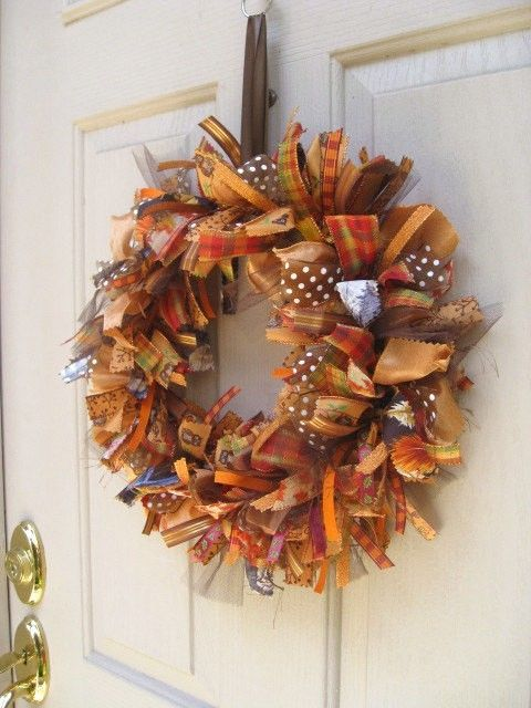 18 inch strips of ribbon tied in knots around a straw wreath. Fall wreath