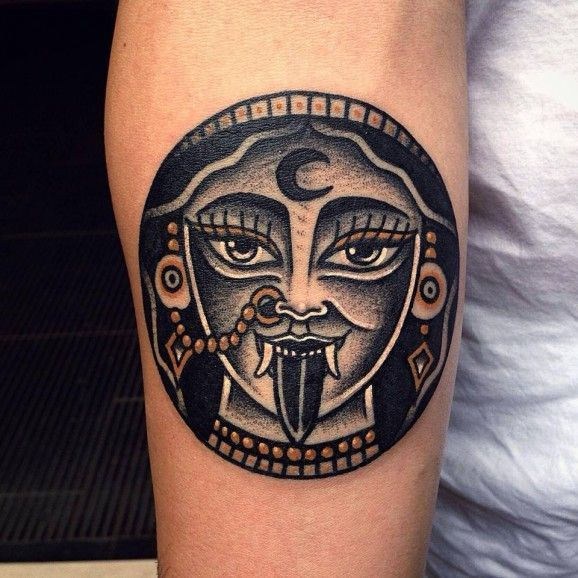 You can go for something simple yet badass. Here a fun Kali tattoo by Vinz Flag.