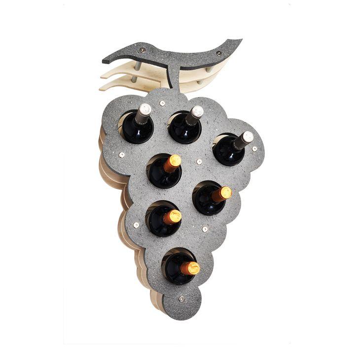 """Il portabottiglie da parete modello """"Bunch"""" viene realizzato con diversi tipi di pietre naturali. Rende esclusivi e ricercati ambienti come: cucine, taverne, saloni. Ottimo e consigliato per ristoranti, bar, cantine vinicole, enoteche. Perfetto come idea regalo. Capienza: 7 bottiglie"""