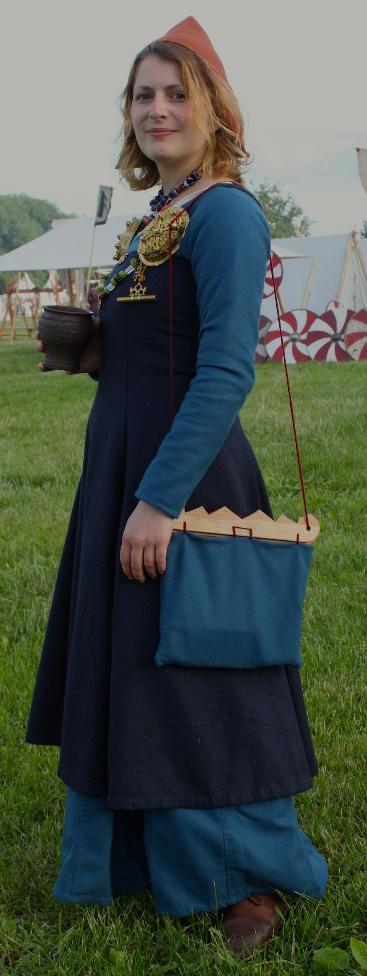 Blue apron dress - Hedeby Dress In Woad Dyed Twill Is Finished Handsewn With Waxed Linen Thread Here Seen Together With A York Cap In Wool An Apron Dress And A Bag Based On