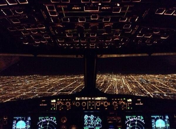 Chicago at night, from the cockpit of a plane.