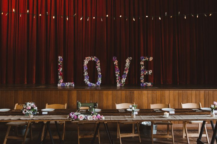 vintage timber trestle tables, wooden padded folding chairs, Berry school of arts, south coast weddings, south coast party hire
