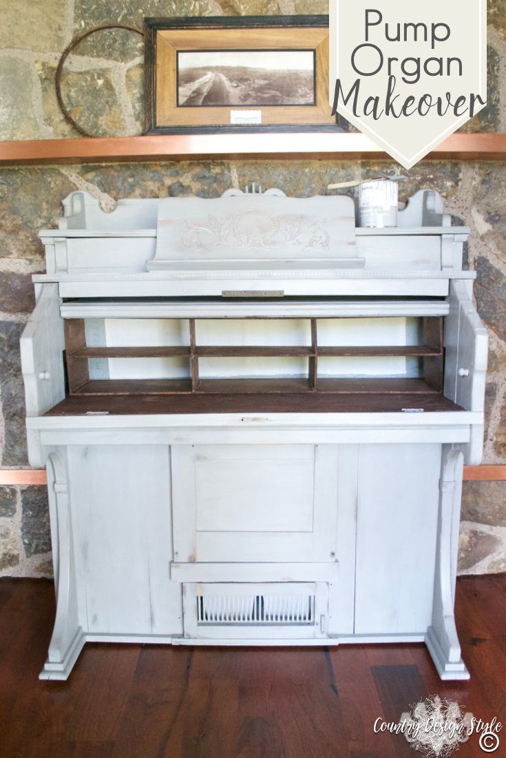 I adore this makeover of an old pump organ into a organized desk with loads of storage. Storage in the bottom too! Click to see more! | Country Design Style | countrydesignstyle.com