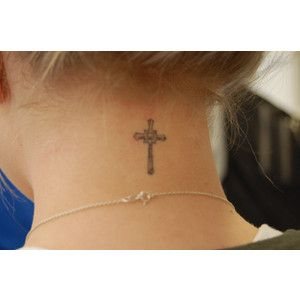 Girl With Cross Tattoo On Nape