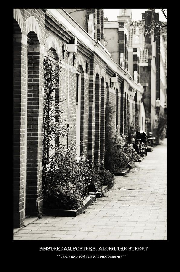 Amsterdam Posters. Along The Street by Jenny Rainbow.  Big collection of Amsterdam posters with black framing with concept of city architecture and street photos. This collection offering the same style for all the images and perfectly suits for wall decor of the bars and restaurants or minimalistic home interiors.