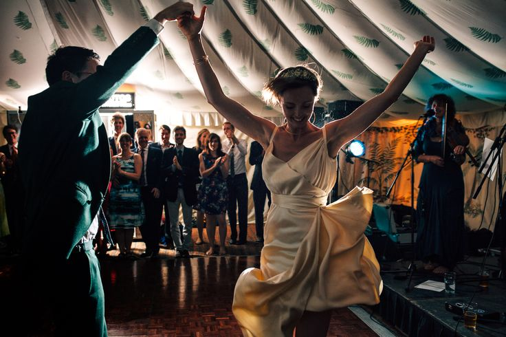 Dancing within our 40' x 100' Traditional Canvas Pole Tent with Green Fern roof lining.