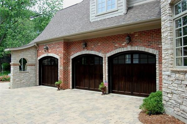 Garage doors lights over each home outside spaces for Outer doors for homes