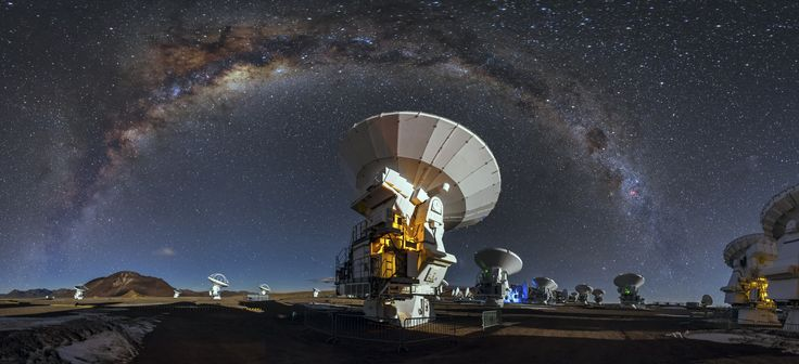 Like a celestial blanket the Milky Way forms an arc high above the antennas of the Atacama Large Millimeter/submilimeter Array. This arc is caused by the panoramic view of the image. Credit: Adhemar Duro/European Southern Observatory  (www.eso.org)  Ps. This one is a much better post processed version of my Tribute to Carl Sagan: https://500px.com/photo/73587169/tribute-to-carl-sagan-by-adhemar-duro